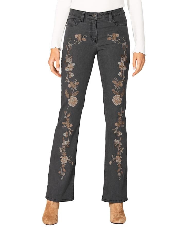 Jeans mit Blütenstickerei im Vorderteil