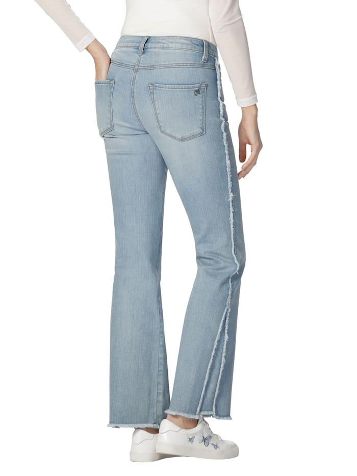 Jeans med frynser langs siden