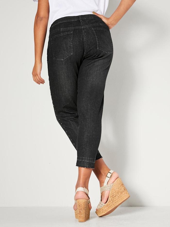 Jeans med nagler langs siden