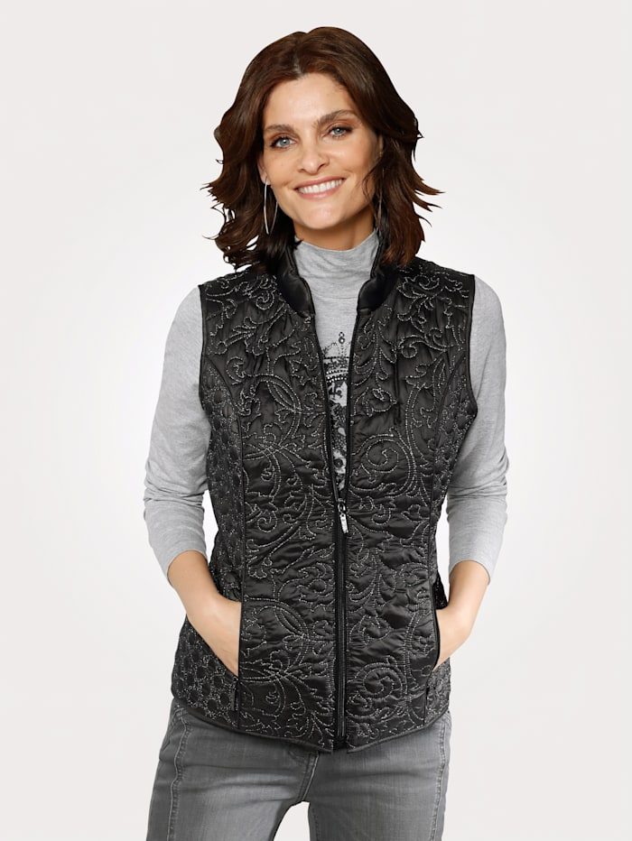 Gilet with decorative shimmeringyarn