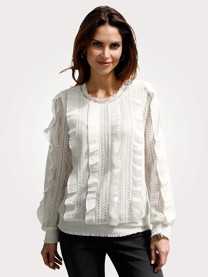 Pull-on blouse with intricate lace detailing