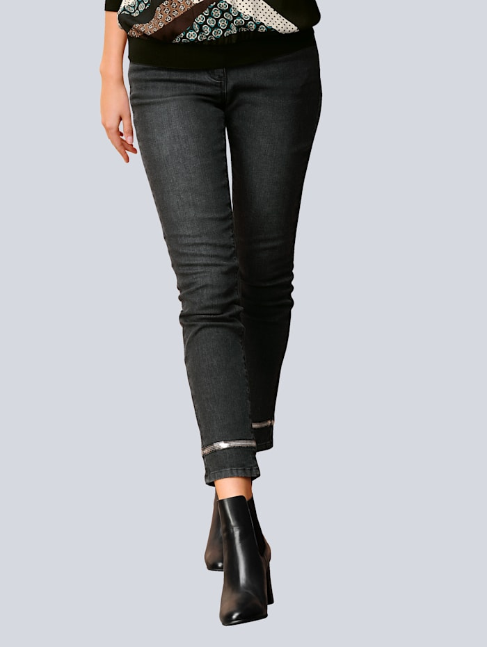 Jeans mit effektvollem Paillettendetail am Saumabschluss