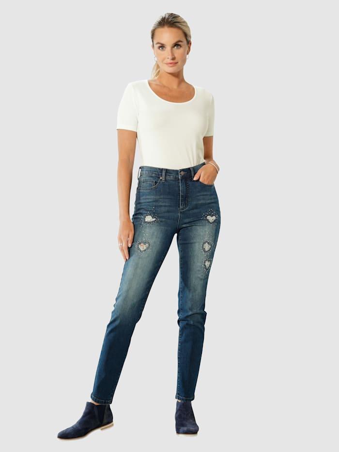 Jeans med hjerteformede cut-outs