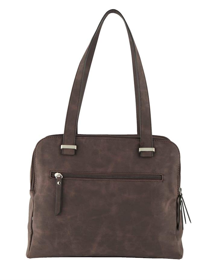Handbag with stylish cutout detailing