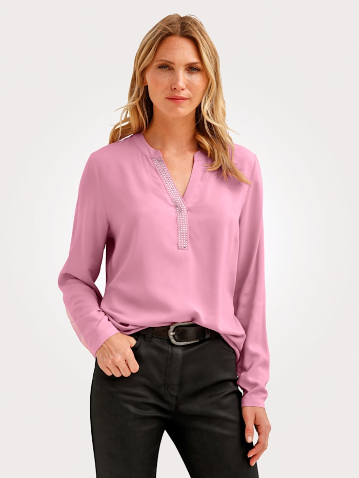 Pull-on blouse made from a soft, flowing fabric