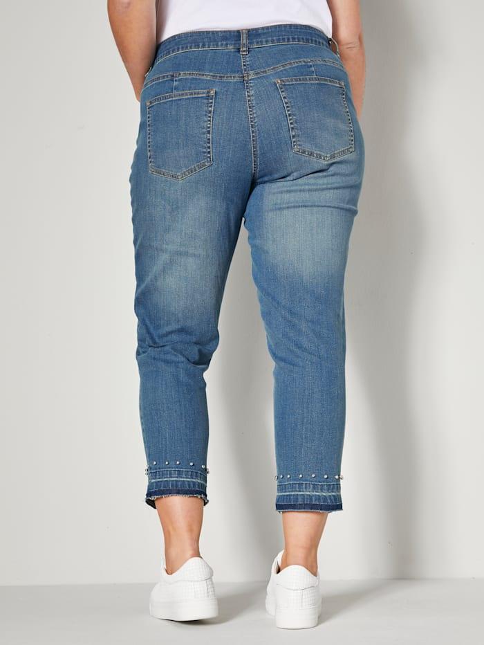 Jeans med dekorpärlor nedtill
