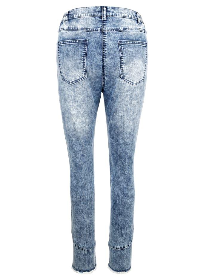 Jeans med frynser