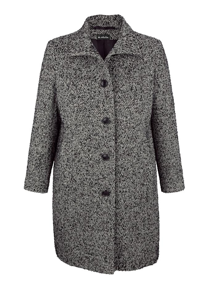 Manteau à maille bouclée contrastante