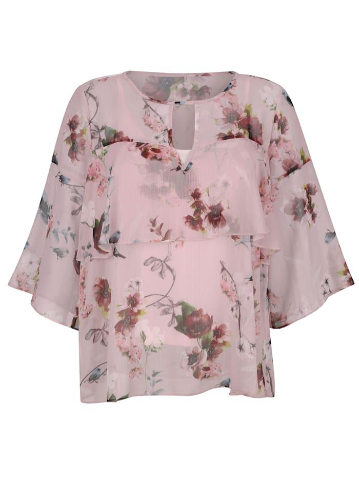 Blus och linne med blommigt mönster