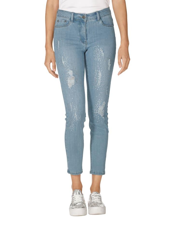 Jeans met strassteentjes en destroyed effecten