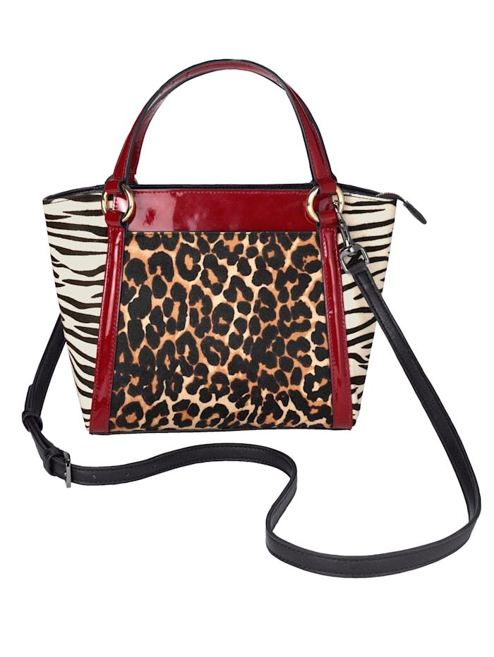 Handtasche in extravagantem Materialmix