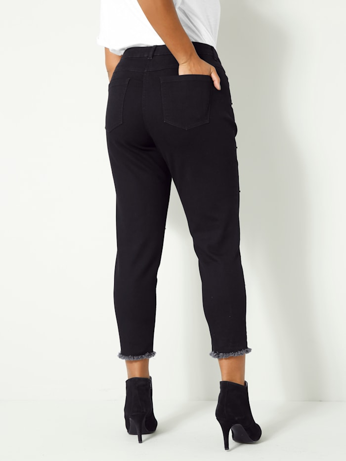 Jeans met sierkraaltjes