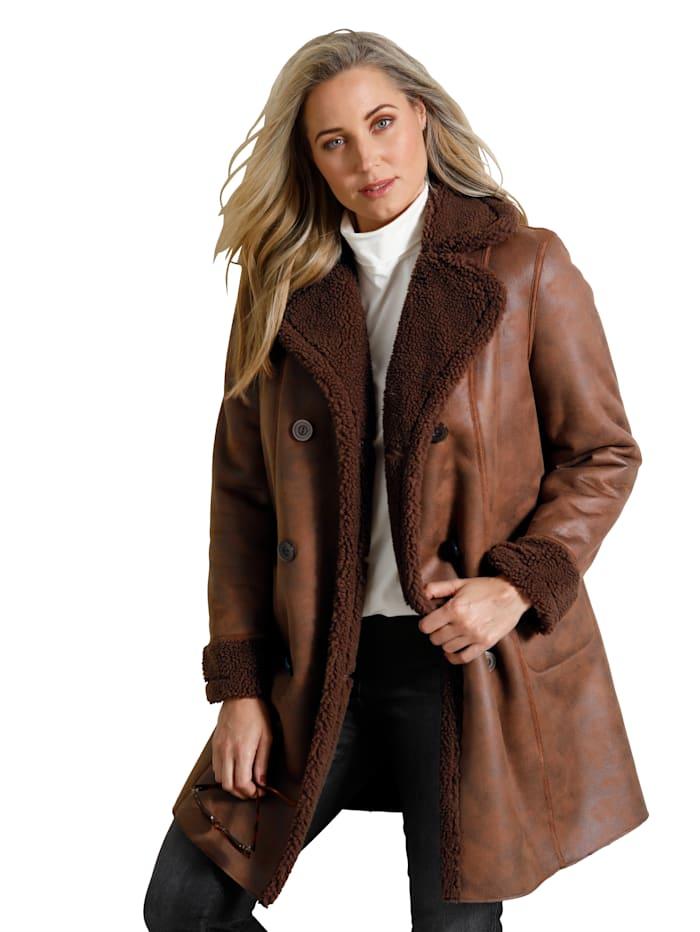 Manteau en simili d'aspect toison d'agneau