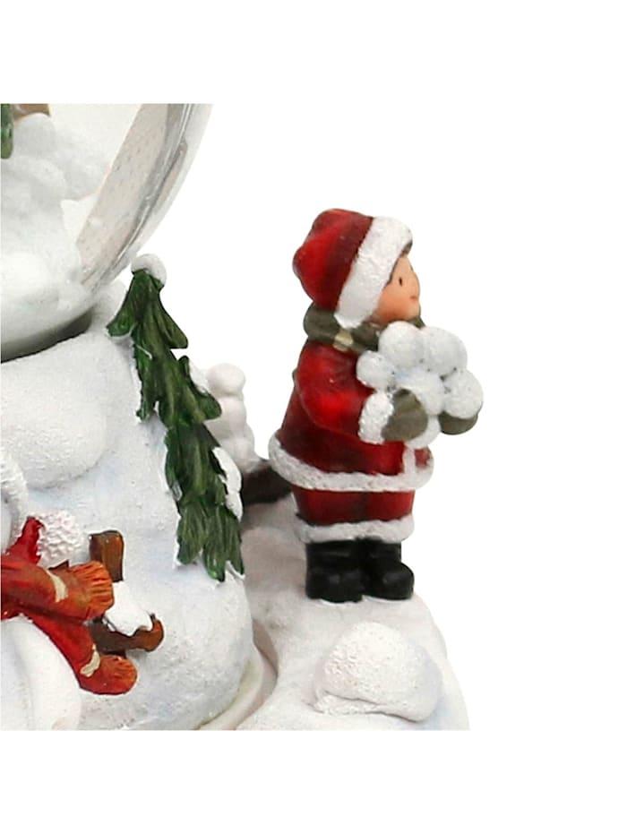Schneekugel Kinder auf Schlitten