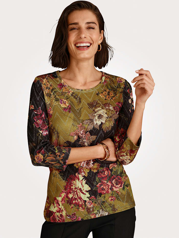 Top with shimmering thread