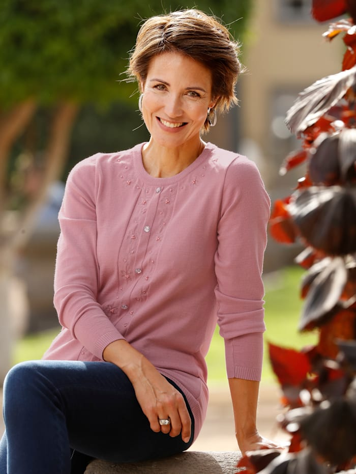 Paola Trui met bloemenversiering, Oudroze