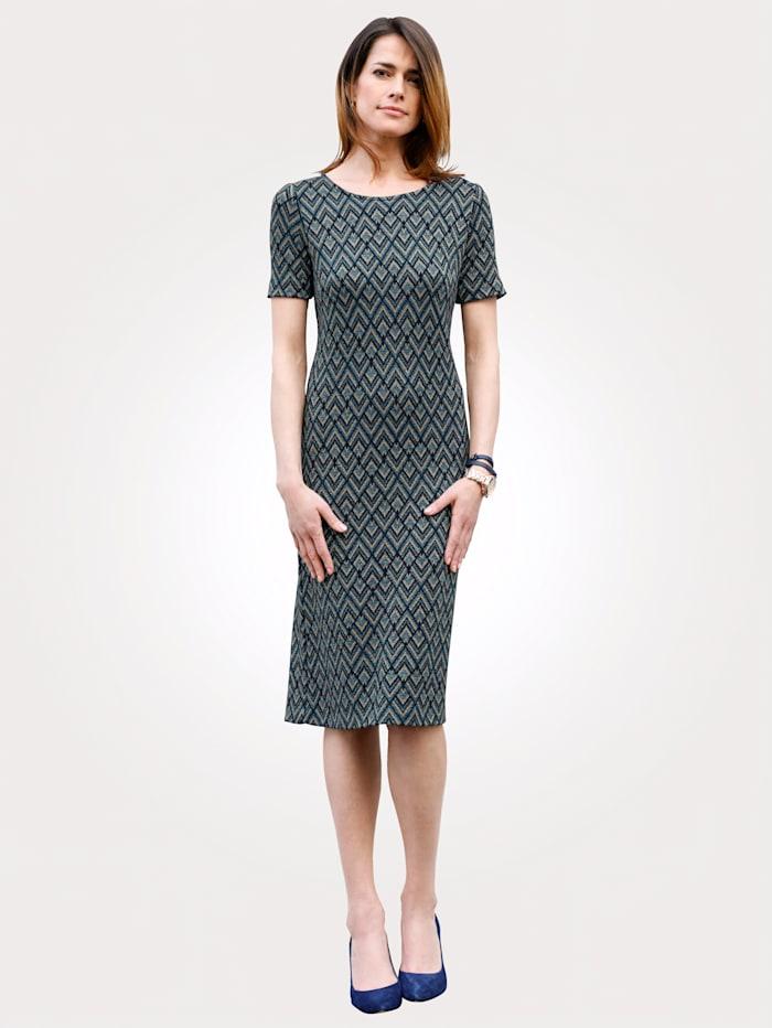 Stickad klänning med grafiskt jacquardmönster