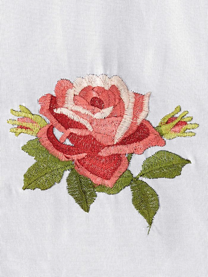 En gardin med en rosett