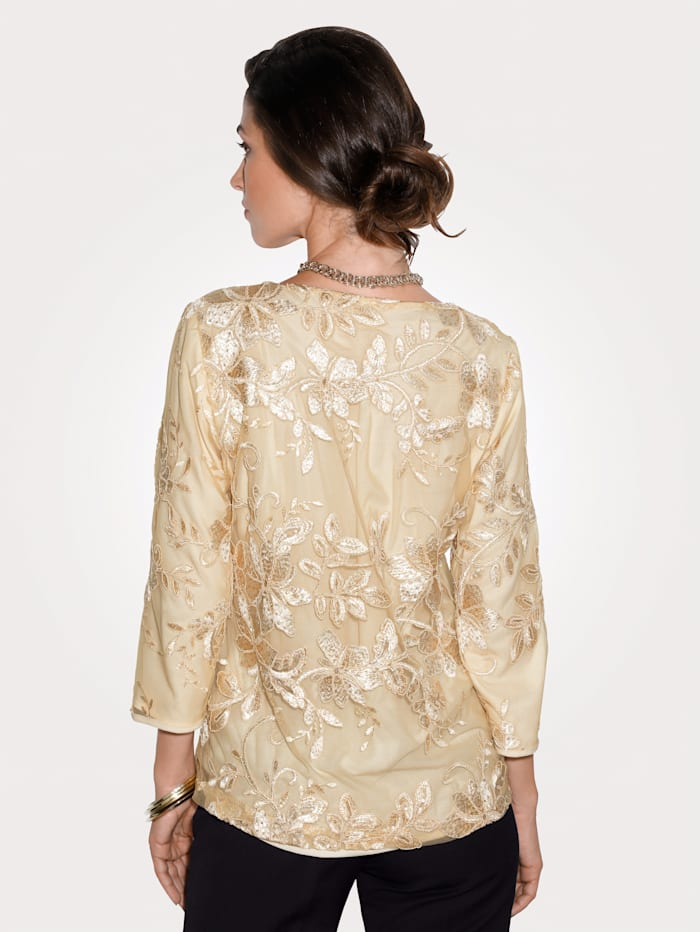 Top with embroidery and sequins