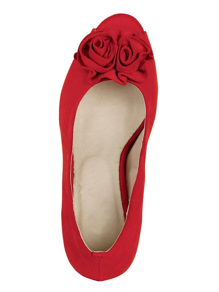 Platform peep toe shoes with a joyful floral embellishment
