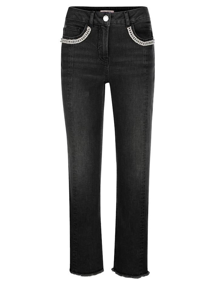 Jeans met band met siersteentjes op de zakken