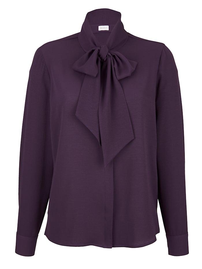 Tie neck blouse in a versatile design