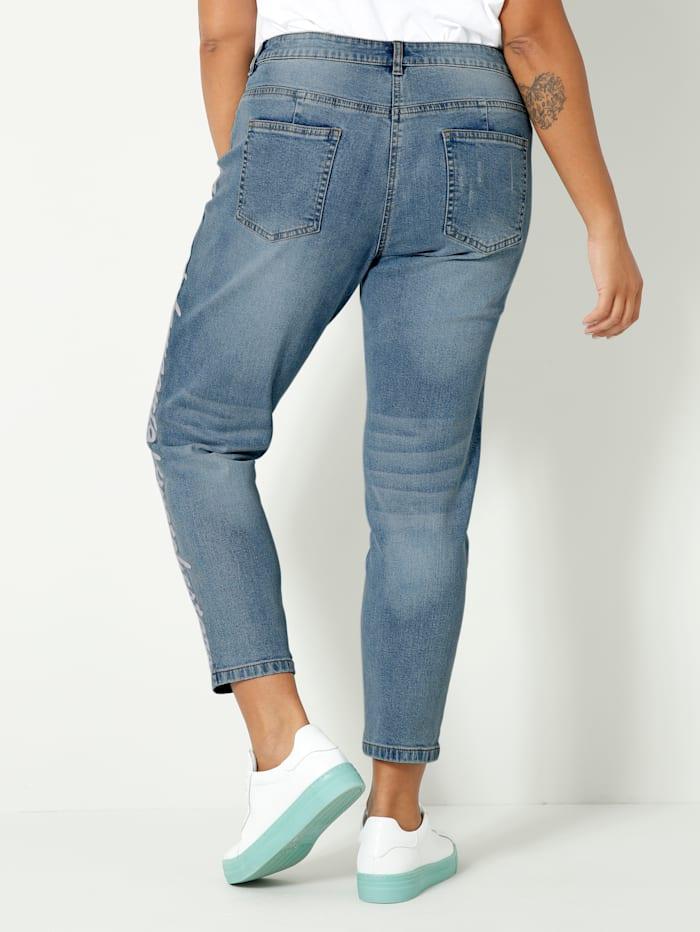 Jeans met opschrift opzij