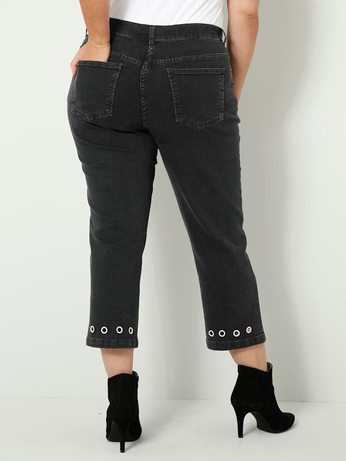 Jeans met oogjes aan de zoom