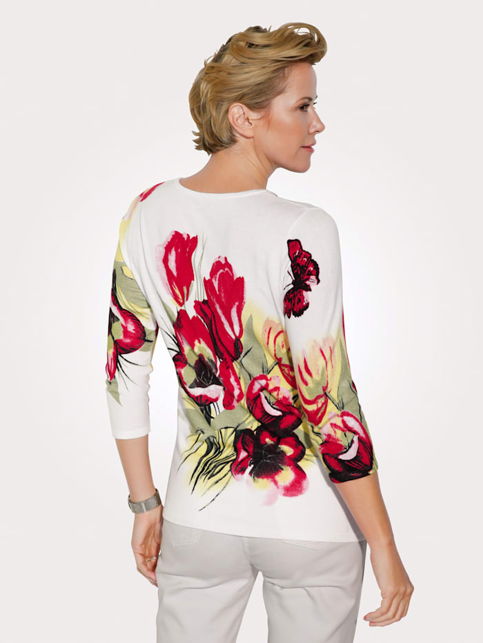 Jumper with a bright butterfly print
