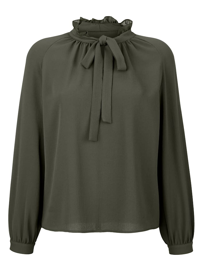 Blouse with a tie neck and frills