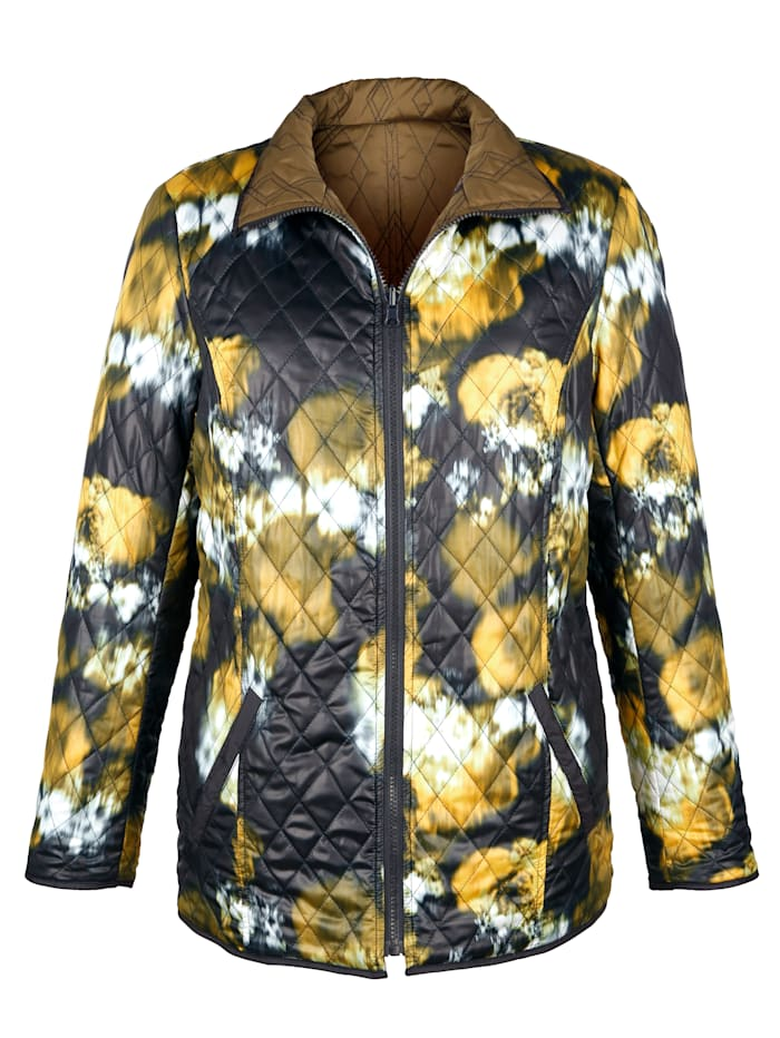 Reversible jacket with an abstract print