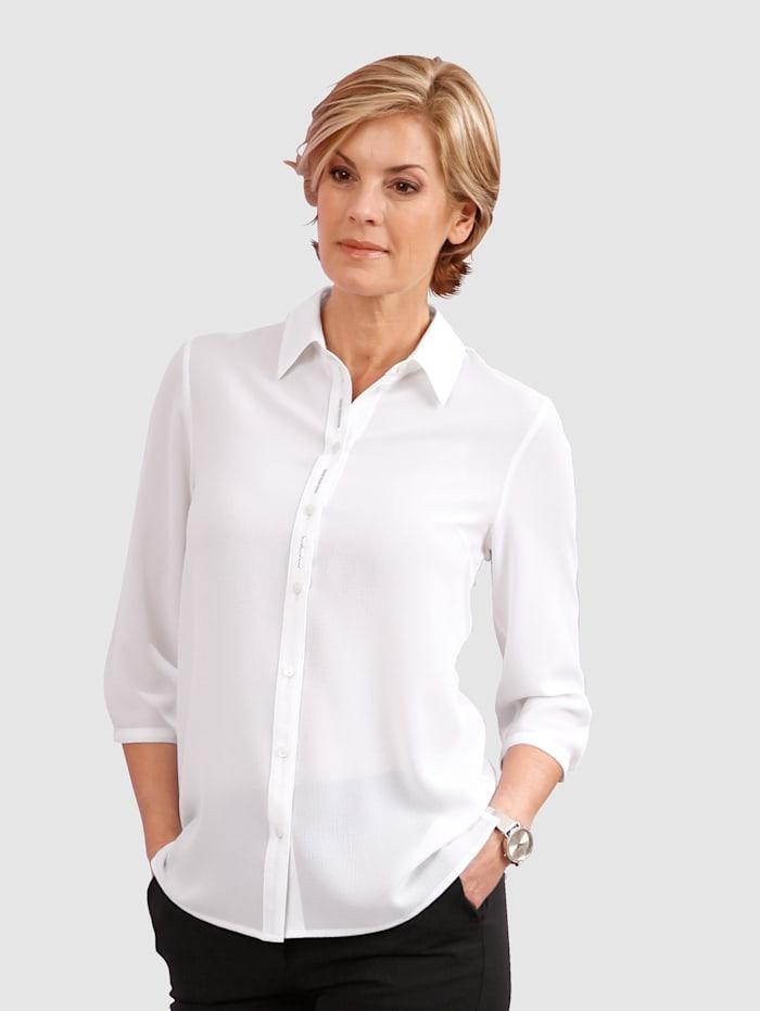Niittisomistettu paitapusero