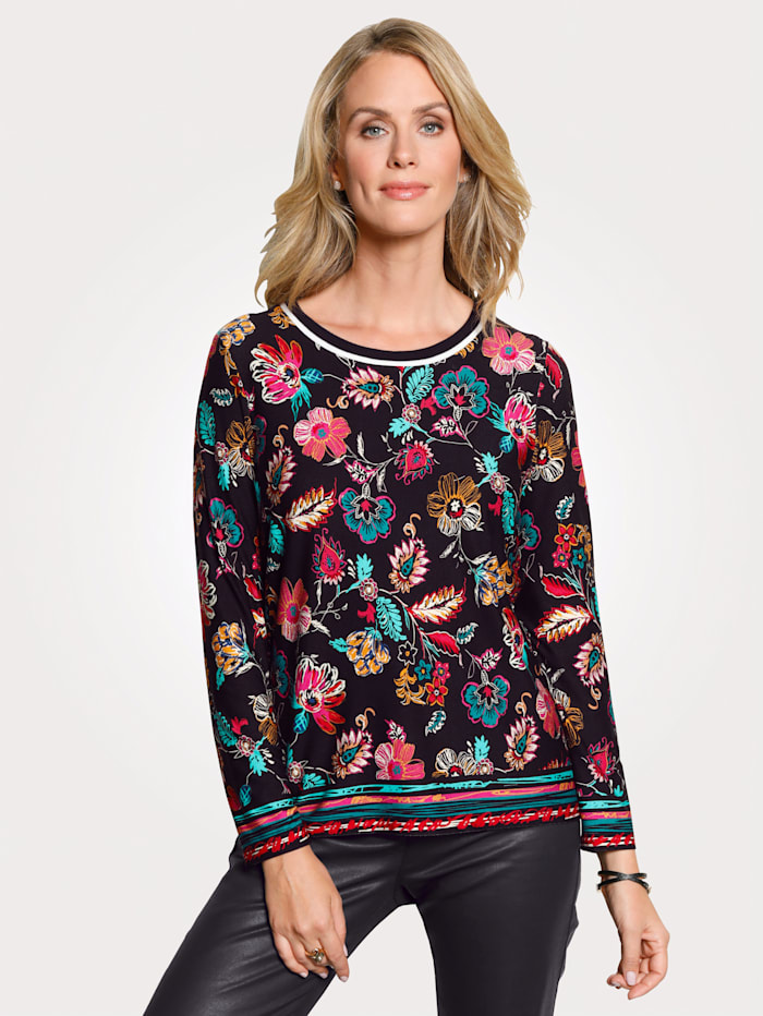 Top with an eye-catching floral print