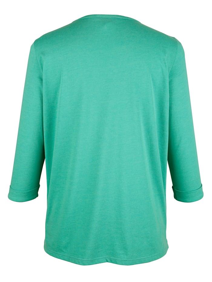 Niittisomisteinen paita