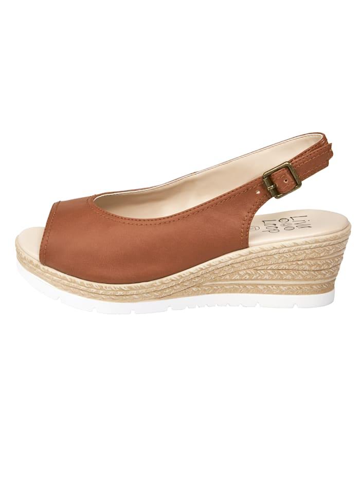 Sandales compensées avec empiècement extensible sous la boucle