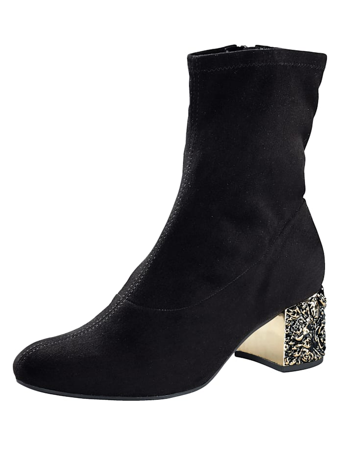 Ankle boots with a gold colored heel