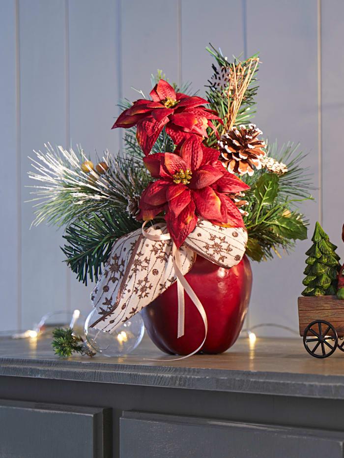 Joulutähtiasetelma omenaruukussa