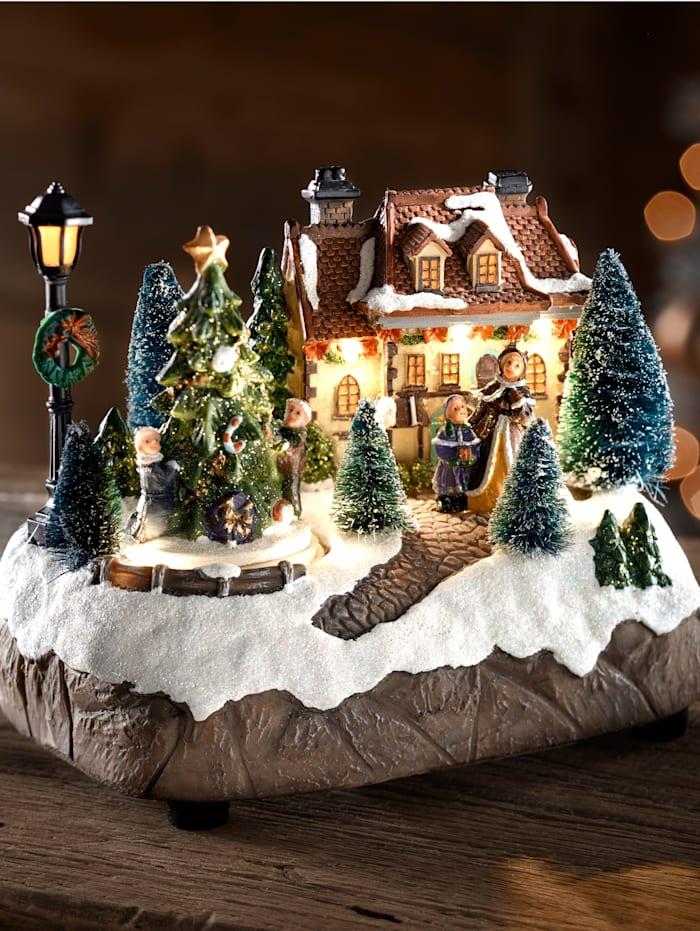 Näve Julstad med snurrande julgram, flerfärgad