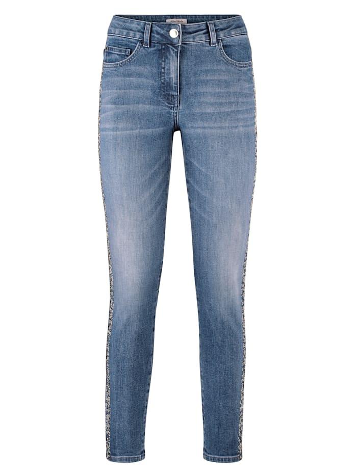 Jeans met strasgalonstreep opzij