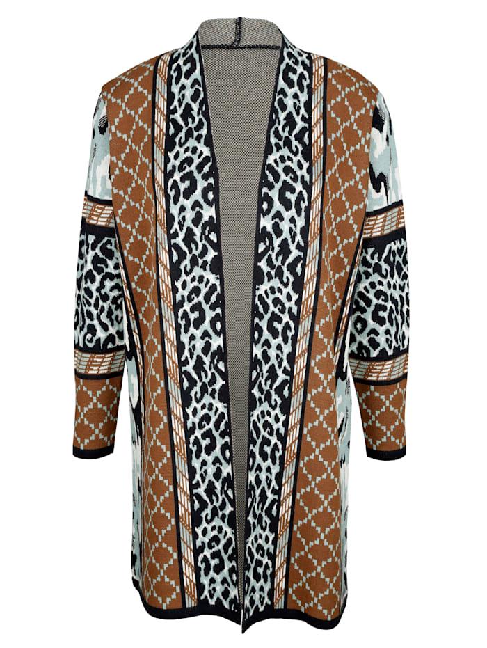 Dlouhý svetr s módním mixem vzorů