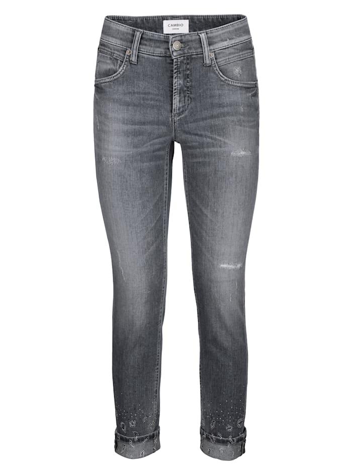 Jeans mit Strasssteinchen am Saum