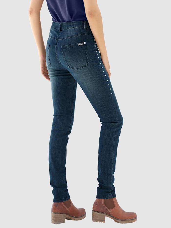 Jeans med dekorplattor