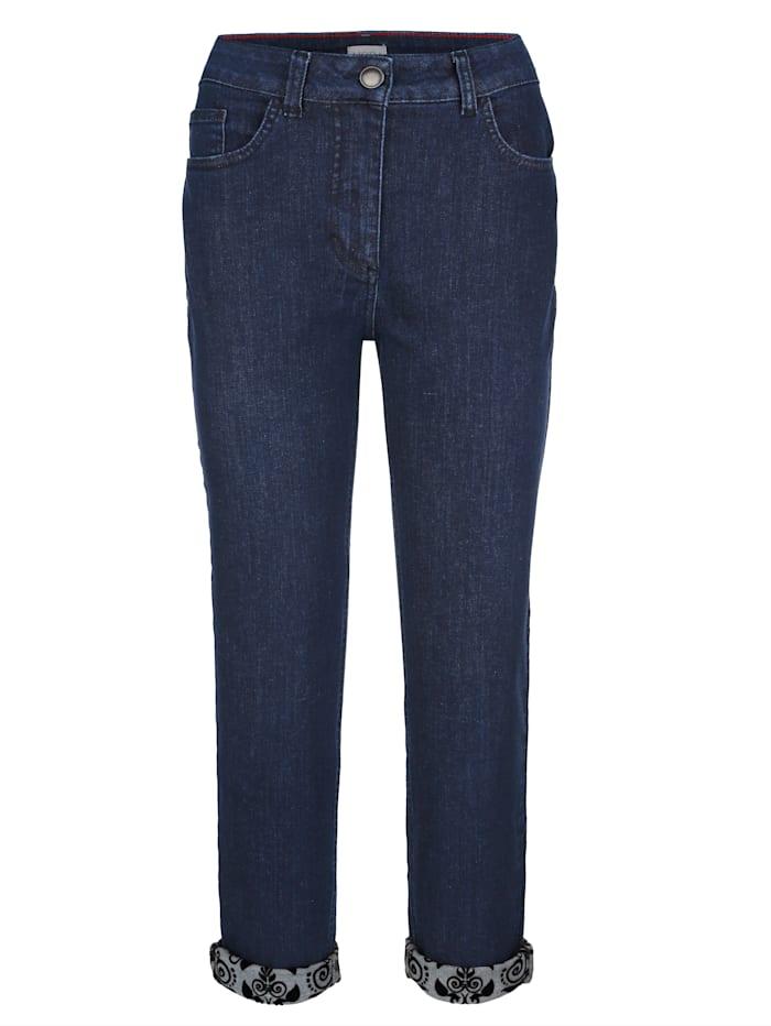 Jeans mit Flockdruck in floralem Dessin