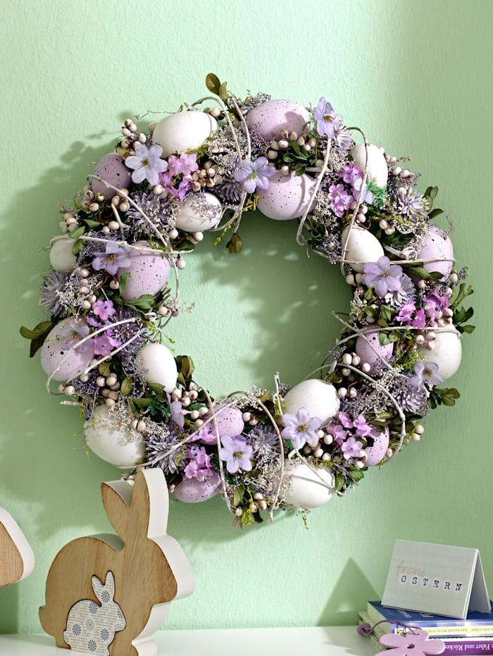 Kranz mit Eiern und Blüten