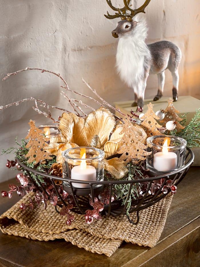 Kerststukje met magnolia