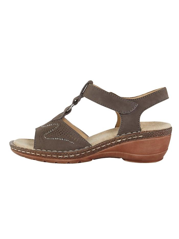 Sandaaltje met modieuze perforaties