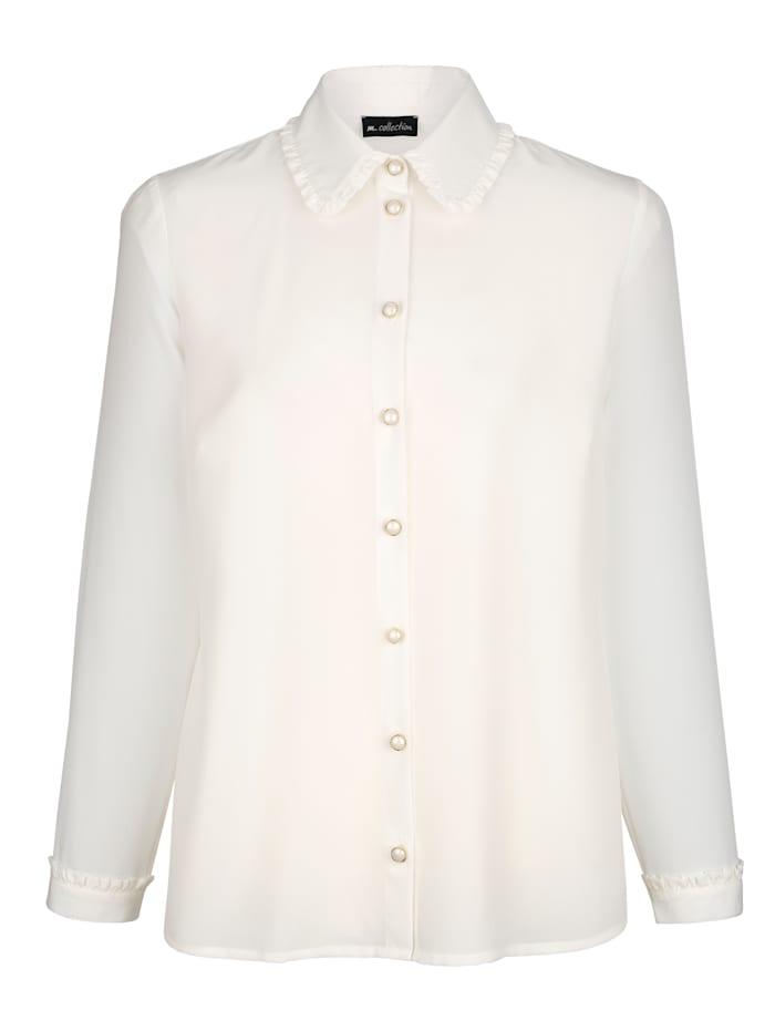 Röyhelösomistettu paitapusero