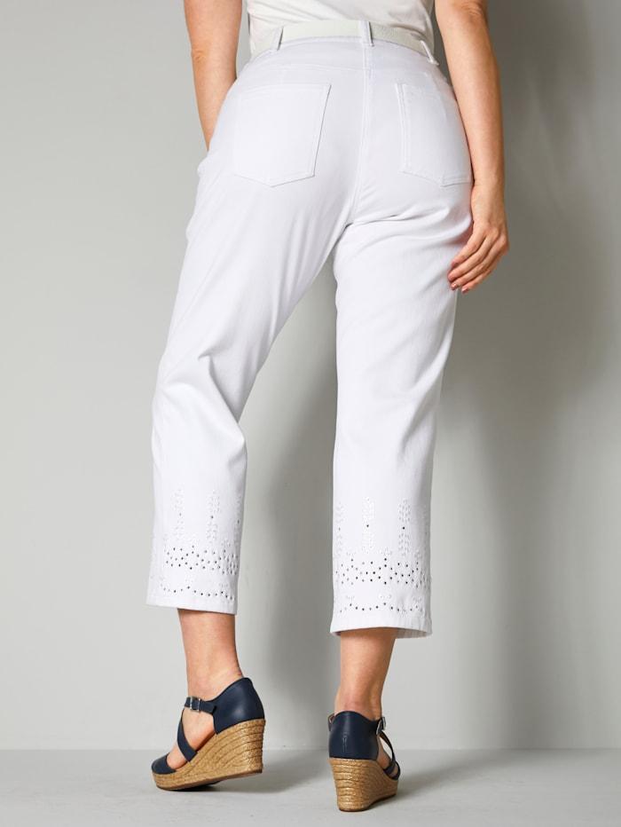 Jeans met opengewerkt borduursel