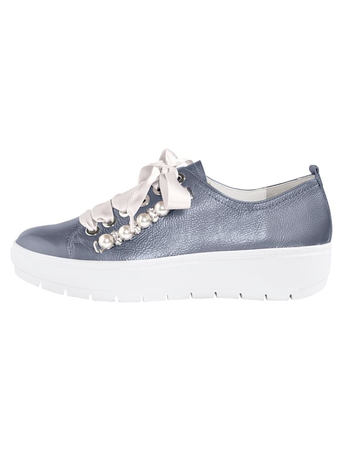 Lace up shoes with fashionable embellishments