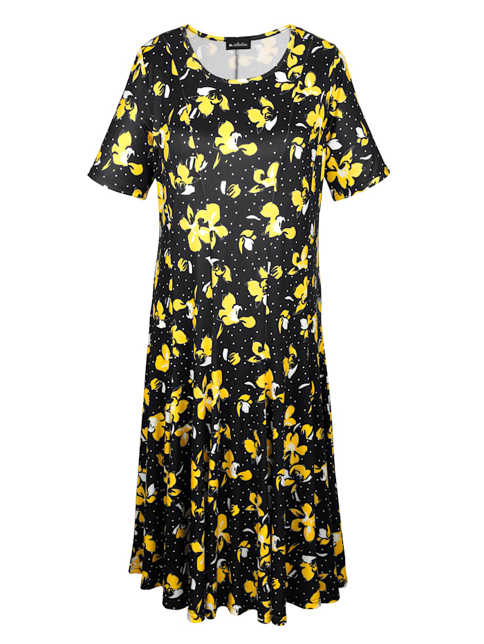 Kjole med blomster- og prikkemønster